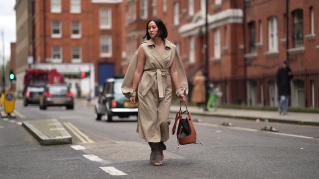 tiffany hsu wears a brown bag a gray and beige trench coat gray pants shoes outside gw anderson during london fashion week february 2020 on february... - brown stock videos & royalty-free footage