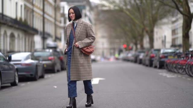 tiffany hsu wears a checked coat a brown bag during london fashion week february 2018 on february 18 2018 in london england - london fashion week stock videos and b-roll footage