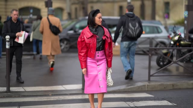 stockvideo's en b-roll-footage met tiffany hsu wears a headband a red leather jacket a black shirt a pink pvc skirt purple shoes outside miu miu during paris fashion week womenswear... - haarband