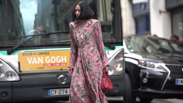 tiffany hsu wears a pink floral print dress, outside thom browne, during paris fashion week womenswear fall/winter 2019/2020, on march 03, 2019 in... - street style stock videos & royalty-free footage