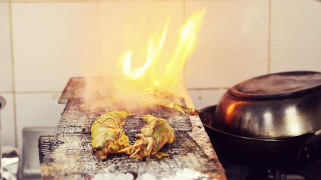tiger prawns on a traditional charcoal grill - food styling stock videos & royalty-free footage