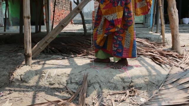 tiger widowdipali repairing a shop near sundarban at satkhira , bangladesh on april 12, 2018. she is a victim of prejudice - widow stock videos & royalty-free footage