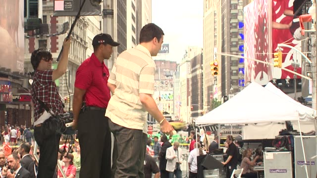 tiger woods and jimmy fallon at the 'showdown on broadway' tiger woods tees off against jimmy fallon at new york ny - jimmy fallon stock videos and b-roll footage