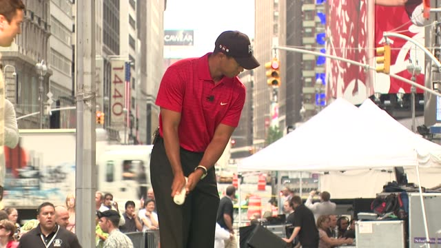 tiger woods at the 'showdown on broadway' tiger woods tees off against jimmy fallon at new york ny - jimmy fallon stock videos and b-roll footage