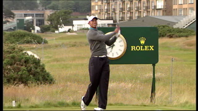 tiger woods chosen as wild card for us ryder cup team r13071005 fife st andrews tiger woods practising his driving shots on golf course - tiger woods stock videos & royalty-free footage