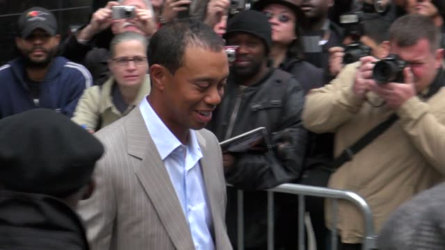 tiger woods exits good morning america 03/15/12 in celebrity sightings in new york - tiger woods stock videos & royalty-free footage
