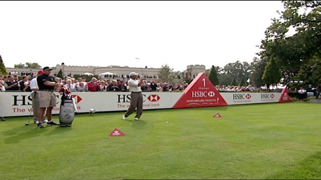 surrey wentworth ext tiger woods at world match play championships tiger mascot woods teeing off - pga world golf championship stock-videos und b-roll-filmmaterial