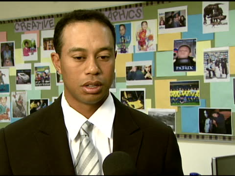 Tiger Woods on his father his influence on the Tiger Woods foundation and on the definition of a fist pump moment is at the Earl Woods statue...