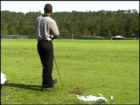 tiger woods practicing golf swings before the att pebble beach national proam tournament tiger woods practices golf swings on january 29 1997 in... - tiger woods stock videos & royalty-free footage