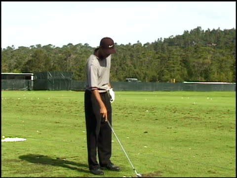 tiger woods practicing golf swings before the att pebble beach national proam tournament tiger woods practices golf swings on january 29 1997 in... - pga event stock videos and b-roll footage