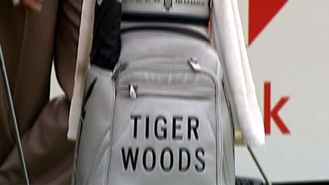 Tiger Woods to take break from golf 1392006 / R13090606 Surrey Wentworth Tiger Woods standing alongside bag of clubs on course