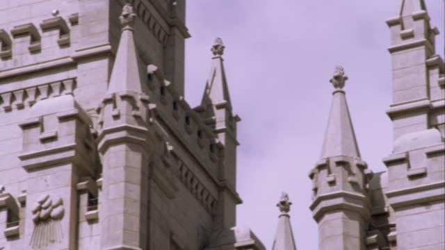 vídeos de stock e filmes b-roll de tight panning shot of the spires of the lds salt lake temple. - mormonism