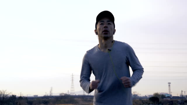 tight shot of a mid adult man running in the morning - morning exercise stock videos & royalty-free footage