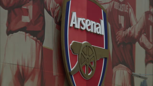 tight shot of arsenal sign outside emirates stadium - healthcare and medicine or illness or food and drink or fitness or exercise or wellbeing stock videos & royalty-free footage