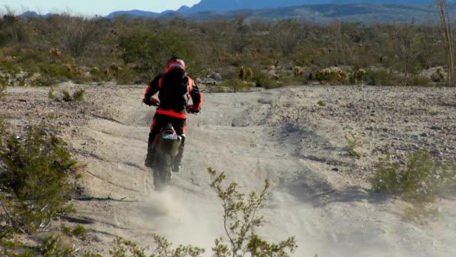 tight shot of motorbike wheels in desert - baja california peninsula stock videos & royalty-free footage
