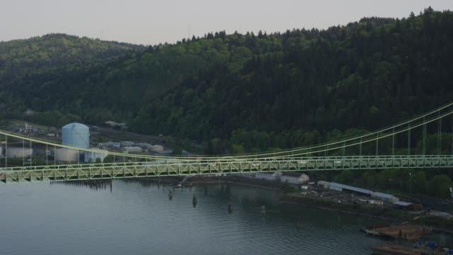 tight shot of suspension bridge with city reveal - suspension bridge stock videos & royalty-free footage