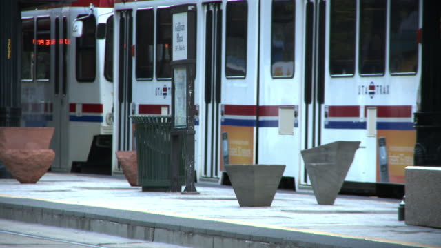 tight shot of tram pulling up to stop the passengers getting off. - cable car stock videos and b-roll footage