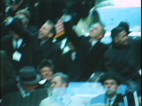 stockvideo's en b-roll-footage met tight shot off sticks of astronauts jim lovell frank borman and william anders standing in the backseat of a convertible they are all looking out to... - passagiersstoel