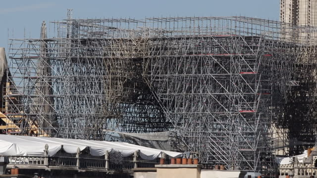 tight shot on the Notre Dame cathedral with the tarpaulin replacing the roof of the cathedral to protect it from the weather scaffolding