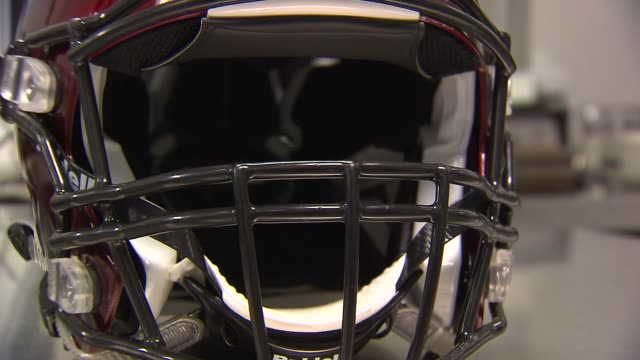 wgn tight shots of a red impactsensing football helmet at a riddell testing lab in rosemont ill - brain damage stock videos & royalty-free footage