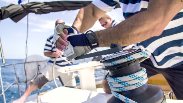 cu tightening the sail - crew stock videos & royalty-free footage