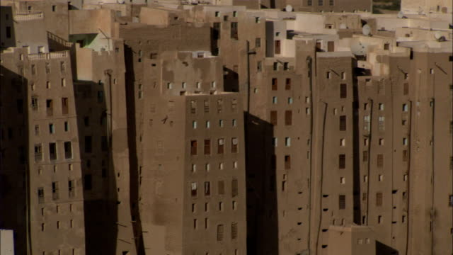 tightly packed mud brick high rises fill the town of shibam yemen. - yemen stock videos & royalty-free footage