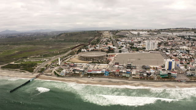 tijuana mexico border wall aerial shot - baja california peninsula stock videos & royalty-free footage