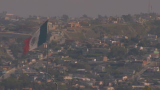 tijuana, mexicoflag of mexico flying over city - baja california norte stock videos & royalty-free footage