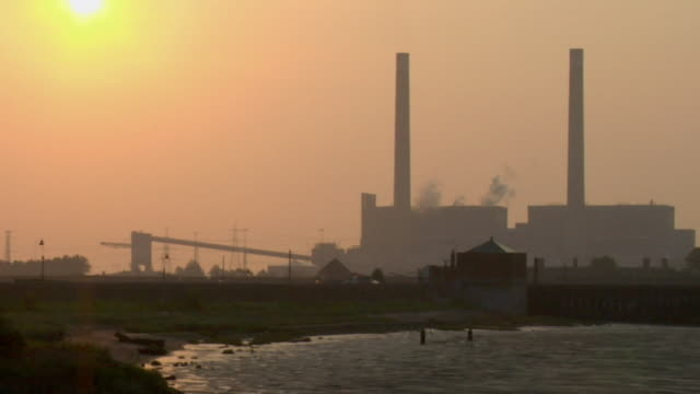 MS, Tilbury power station by river Thames at sunrise / Essex, England