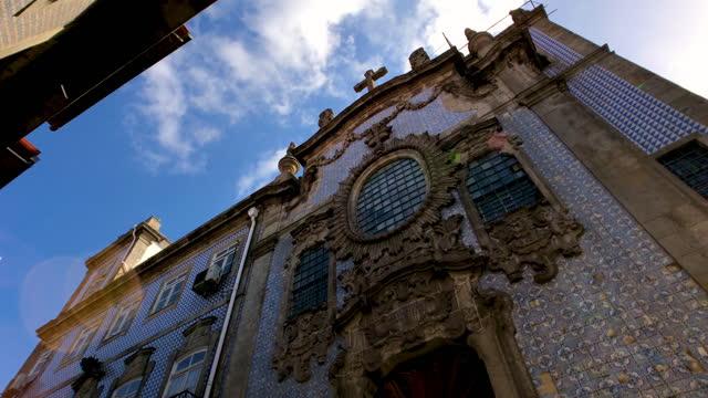 tiled facade of third order church in porto, portugal - kreuzbein stock-videos und b-roll-filmmaterial