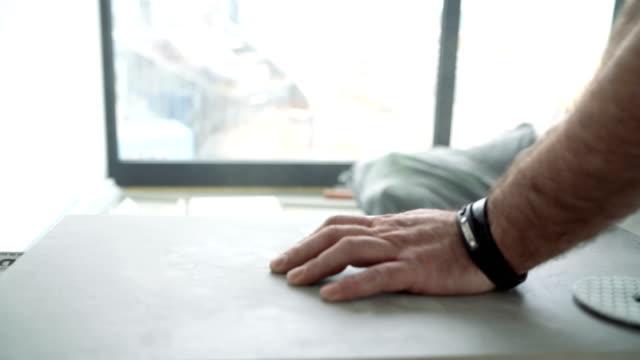 tiler polishing floor tile before installation - polishing stock videos & royalty-free footage