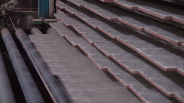 Tiles move along a conveyor towards a kiln at the Shabbir Tiles Ceramics Ltd production facility in Karachi Pakistan on Wednesday Dec 6 Tiles move...