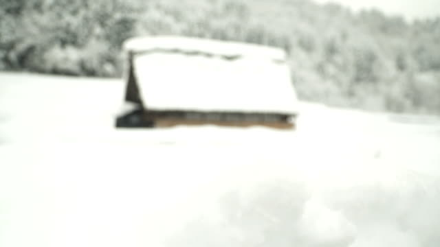 tilt: a japanese traditional house at shirakawago village under snow - shack stock videos and b-roll footage