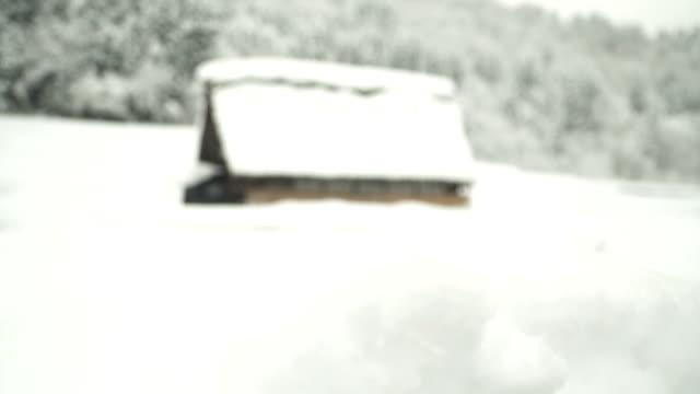 Tilt: a japanese traditional house at Shirakawago village under snow
