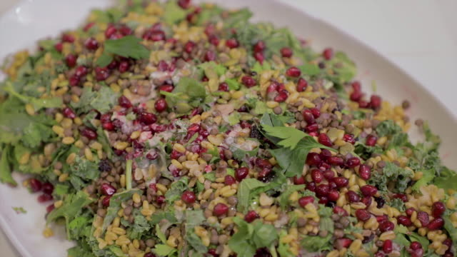 tilt and pan across a fresh and healthy salad - quinoa salad stock videos & royalty-free footage