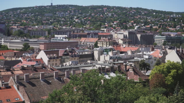tilt cityscape and landscape view: the rooftop of hungarian resident and building in budapest from the viewpoint on the area around the palace in a sunny day of summer and blue sky, hungary. - hungary stock videos & royalty-free footage