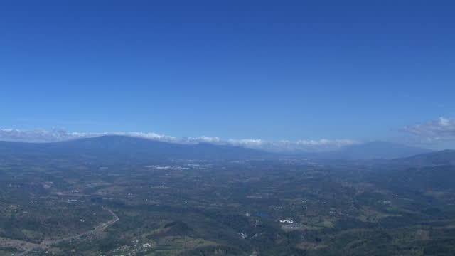 tilt down aerial shot of landscape with mountains and balsa, costa rica, in alajuela province. - tropiskt träd bildbanksvideor och videomaterial från bakom kulisserna