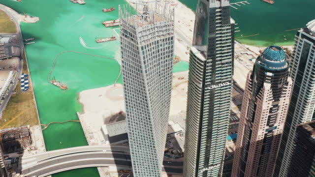 tilt down aerial view of skyscrapers around dubai marina, united arab emirates - architecture stock videos & royalty-free footage