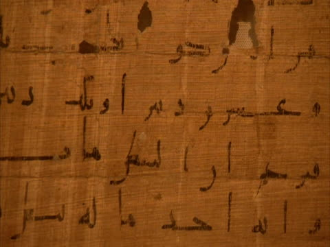 tilt down ancient islamic writing parchment, egypt (sound available) - message stock videos & royalty-free footage
