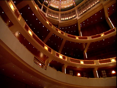 tilt down and pan right from upper tiers to empty auditorium and stage - concert hall stock videos and b-roll footage
