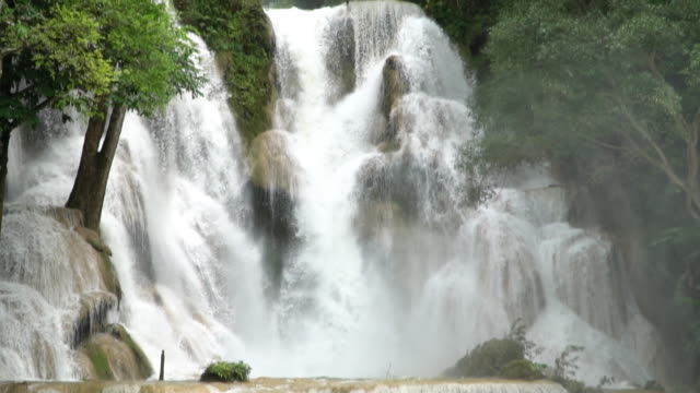 Tilt down and Slow motion of Kuang Si waterfall in Luang Prabang, Laos.
