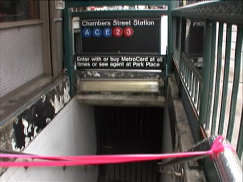 tilt down and up mcu chambers street subway entrance roped off with pink tape during daytime - roped off stock videos & royalty-free footage