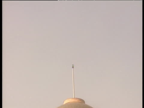 Tilt down and zoom out from sky to Indian parliament (Lok Sobha) New Delhi