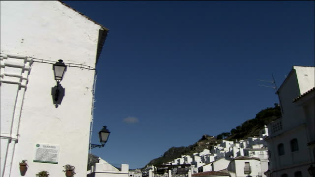 Tilt down blue sky to main square of St Sebastian, Spain