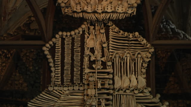Tilt down Bone church interior Kutna hora Czech Republic
