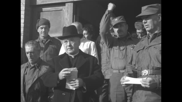 Tilt down Cardinal Francis Spellman and other army officers enter Italian Red Cross Hospital / Croce Rossa Italiana Ospedale Attend No 68 sign above...