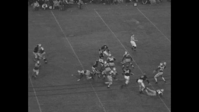 Tilt down Charles OÍRourke throws a pass to UCLA's Jackie Robinson