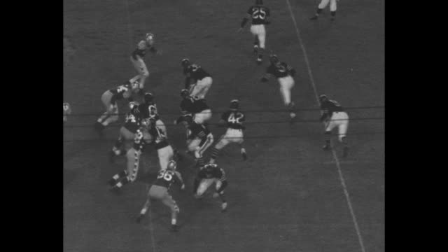 tilt down chicago bears sid luckman passes to william osmanski for a five yard gain in charity game - 1941 stock videos & royalty-free footage