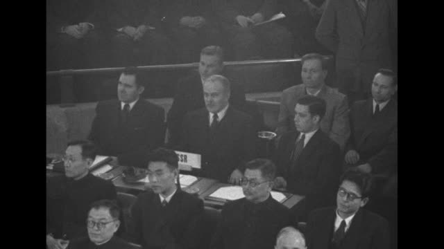 tilt down chinese premier zhou enlai and other chinese dignitaries with placard in front of them for proc / russian foreign affairs minister... - 1954 stock videos & royalty-free footage
