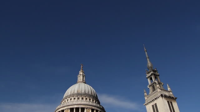 tilt down clear blue sky to reveal st. paul's cathedral, london - tilt stock videos and b-roll footage